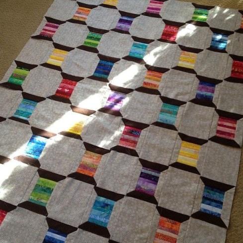 Batik spool quilt